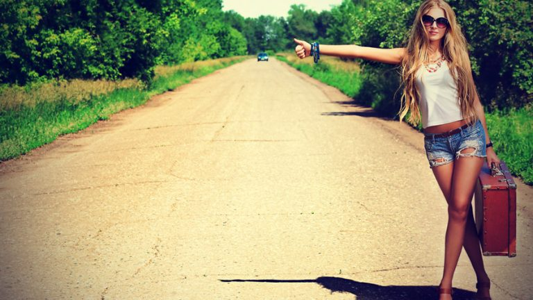 beautiful-hitchhiking-woman-in-a-country