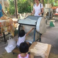 Making rice noodle in Mekong Delta trip with ALO Travel Asia